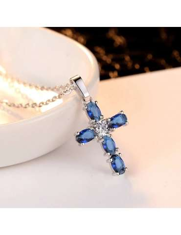 cross-blue-silver-necklace-pendant-cubic-zirconia-gemstone-jewelry-birthstone-warm-background-hihoney-hn028