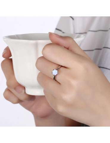 minimalist-white-opal-silver-jewelry-set-healing-ring-model-woman-holding-cup-hihoney-hn010