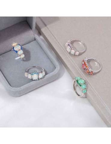 five-fire-opal-rings-gemstone-jewelry-grey-brown-ecru-background-hihoney-hr011