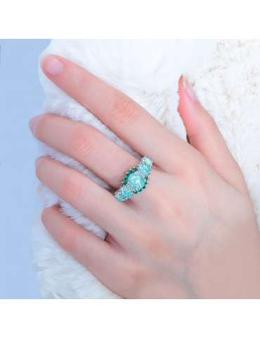 white-green-opal-emerald-ring-gemstone-jewelry-blue-background-woman-hand-hihoney-hr013