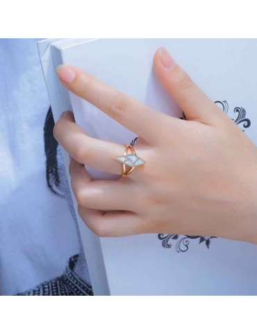 rose-gold-plated-ring-white-opal-gemstone-jewelry-blue-background-woman-hand-hihoney-hr021
