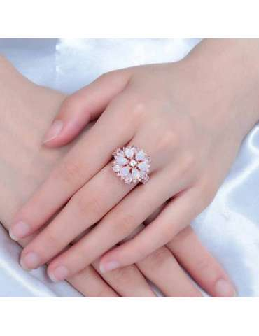 rose-gold-pink-opal-white-zirconia-healing-ring-gemstone-jewelry-woman-hands-blue-background-silk-cloth-hihoney-hr023