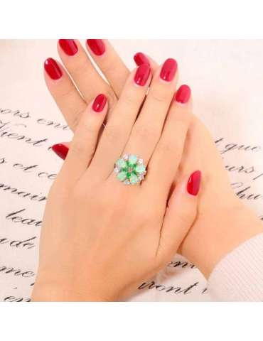 flower-shaped-green-opal-emerald-healing-ring-gemstone-jewelry-woman-crossed-hands-red-nails-letter-background-hihoney-hr027