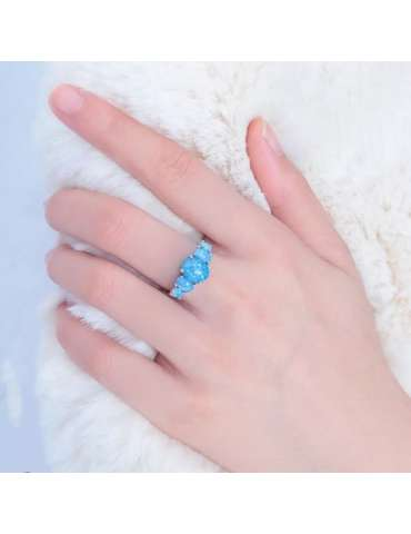 fire-blue-opal-silver-ring-gemstone-jewelry-woman-hand-on-fur-hihoney-hr019
