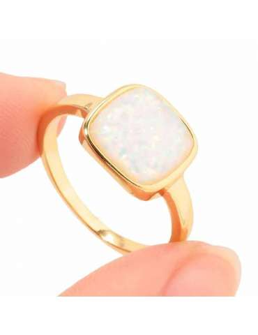 gold-plated-white-opal-silver-healing-ring-gemstone-jewelry-fingers-holding-ring-white-background-hihoney-hr025