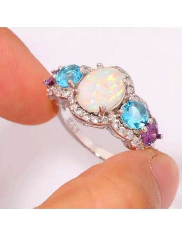 ring-with-three-stones-opal-aquamarine-amethyst-silverhealing-gemstone-jewelry-fingers-holding-ring-hihoney-hr063