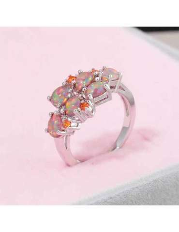 alluring-opal-garnet-orange-silver-healing-ring-gemstone-jewelry-pink-background-hihoney-hr066