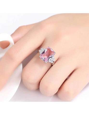 beautiful-pink-white-stone-ring-zirconia-healing-ring-gemstone-jewelry-woman-hand-white-cup-white-background-hihoney-hr072