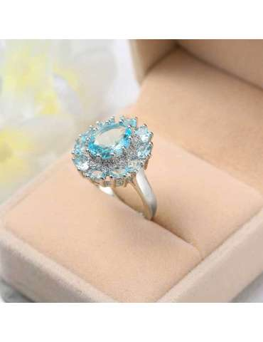 light-blue-aquamarine-white-zirconia-silver-healing-ring-gemstone-jewelry-ecru-brown-background-hihoney-hr078