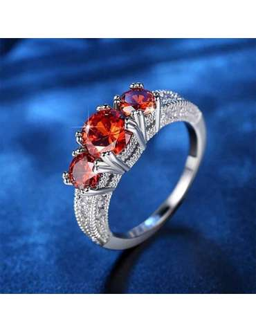red-garnet-zirconia-silver-healing-ring-gemstone-jewelry-dark-blue-background-hihoney-hr080