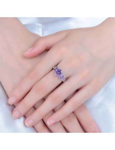 deep-purple-elegant-zirconia-silver-healing-ring-gemstone-jewelry-woman-crossed-hands-white-cloth-background-hihoney-hr081