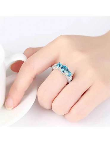 blue-aquamarine-ring-zirconia-silver-healing-ring-gemstone-jewelry-woman-hand-white-cup-white-background-hihoney-hr089